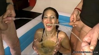 Brunette-drinking-and-swallowing-urinei