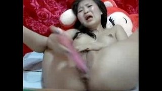Chinese-girl-caught-on-webcam-with-dildo-cum-and-cum