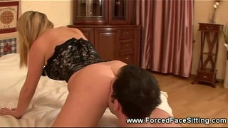 Hot-domina-seized-male-slave-with-her-pussy