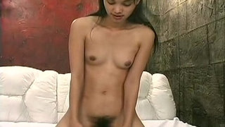 19-years-Asian-Reika-cumming-on-the-sybian
