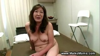Horny-japanese-milf-gets-fingered-and-loves-it