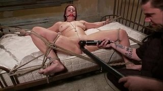 Tied-up-sub-toy-fucked-while-gagged-by-her-master