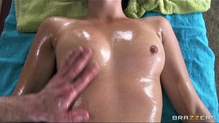 Ella-Milano-is-oiled-up-and-spread-open-during-her-sensual-massage