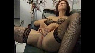 Two-mature-women-masturbating-on-a-couch