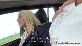 Blonde-stewardess-with-nice-legs-gives-blowjob-in-car