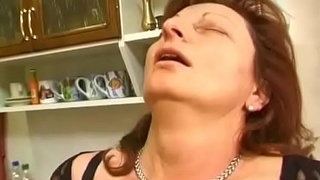 Granny-Gets-Her-Hairy-Pussy-Stuffed-In-The-Kitchen
