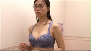 Office-lady-trying-out-bra-after-work