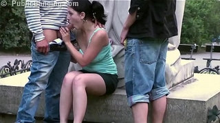 Cute-teen-girl-fucked-by-2-guys-in-PUBLIC-in-center-of-the-city-by-famous-statue