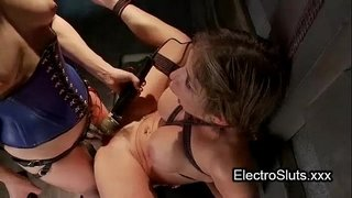 Pale-brunette-babe-bound-in-swing-fucked-with-electro-strapon