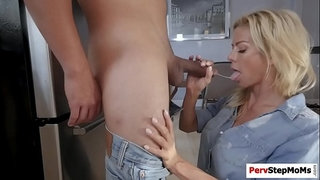 Busty-stepmom-blowjobs-stepson's-huge-dick-on-her-knees